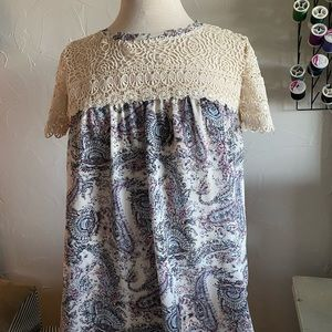 A top with rose designs at the top